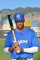 Stefen Henderson (12) of the Ogden Raptors poses for a photo during media day on June 14, 2014 at Lindquist Field in Ogden, Utah. (Stephen Smith/Four Seam Images)