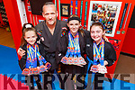 Team BBMA Elite who collected 11Gold, Silver and Bronze medals at the European Championships in Birmingham last weekend, pictured at their academy Blackbelt Martial Arts in Tralee on Tuesday.<br /> L to r: Katelynn Diggins Isabel Shaw, Emily Keane with coach Alan Guilfoyle.