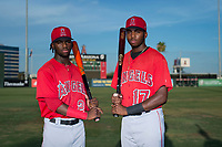 AZL Angels outfielders D'Shawn Knowles (20) and Trent Deveaux (17), both from the Bahamas, pose for a photo before an Arizona League game against the AZL Padres 2 at Tempe Diablo Stadium on July 18, 2018 in Tempe, Arizona. The AZL Padres 2 defeated the AZL Angels 8-1. (Zachary Lucy/Four Seam Images)