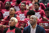 NWA Democrat-Gazette/CHARLIE KAIJO Arkansas Razorbacks head coach Mike Anderson (center) and his wife Marcheita Anderson (left) watch the NCAA selection show, Sunday, March 11, 2018 at Bud Walton Arena in Fayetteville. The Razorbacks will play Butler in Detroit on Friday