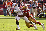 San Francisco 49ers defensive back Ahmed Plummer (29) tackles Cleveland Browns wide receiver Kevin Johnson (85) on Sunday, September 21, 2003, in San Francisco, California. The Browns defeated the 49ers 13-12.