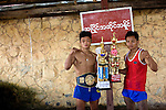 Burmese fighters pose with trophies won in local fights. They are among the best boxers in Burma, but this international match will present them with a new challenge.<br />