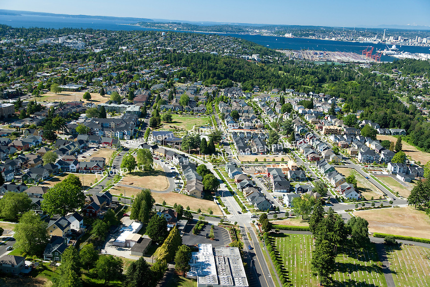 High Point, West Seattle, WA; An aerial view of High Point, a mixed housing development in West Seattle, with the Seattle skyline and Puget Sound in the background.