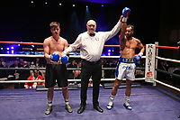 Nathan Junor (white/blue shorts) defeats JJ Smith during a Boxing Show at Cliffs Pavilion on 17th February 2020