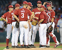 NWA Democrat-Gazette/ANDY SHUPE<br />Arkansas pitching coach Wes Johnson speaks to starter Barrett Loske Memphis Tuesday, April 18, 2017, during the fourth inning at Baum Stadium. Visit nwadg.com/photos to see more photographs from the game.