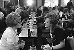 Two middle aged  women having a good chat, saturday night at Byker & St.Peters Working Men's Social Club Newcastle upon Tyne, Tyne and Wear northern England 1973