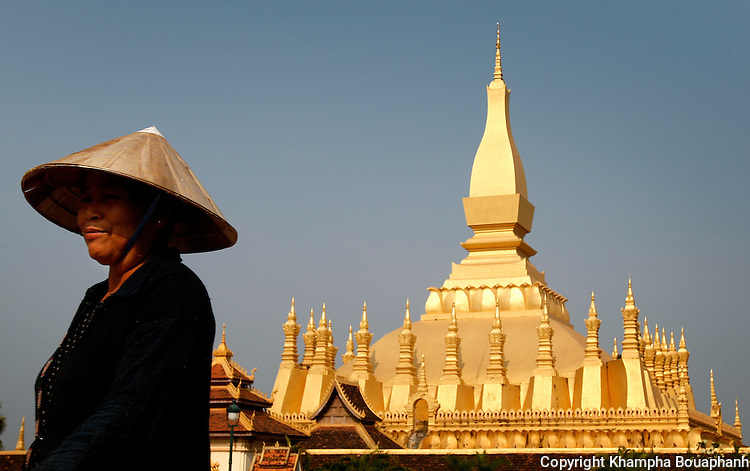 A woman walks on the grounds of Pha That Luang in Vientiane, Laos on Sunday, March 2, 2008.  That Luang has been considered the symbol of Laos since the 16th century Lan Xang Kingdom.  (photo by Khampha Bouaphanh)