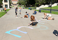Students write supportive messages in chalk as part of Empowerment Week, Oct. 20, 2015 in the JSC quad. Empowerment Week features events and programming dedicated to healing from and preventing dating and domestic violence and sponsored by Project S.A.F.E. (Sexual Assault Free-Environment), a prevention, education, and advocacy program dedicated to addressing issues of sexual assault on campus.<br />
