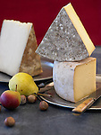 Large wedges of artisanal cheese