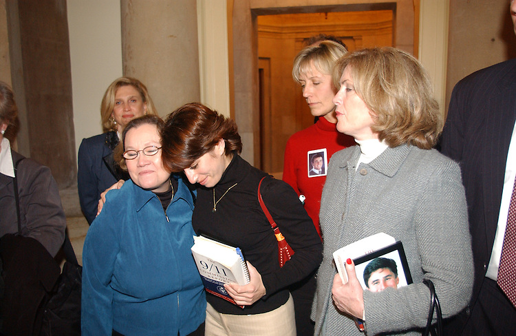 12/06/04.INTELLIGENCE REFORM BILL--Carolyn B. Maloney, D-N.Y., far left, looks on as family members Carol Ashley and Carie Lemack embrace after they exited the offices of House Speaker J. Dennis Hastert, R-Ill., to deliver a petition urging him to schedule a vote on the intelligence reform bill before the imminent end of the 108th Congress. At right are family members Beverly Eckert and Mary Fetchet..CONGRESSIONAL QUARTERLY PHOTO BY SCOTT J. FERRELL