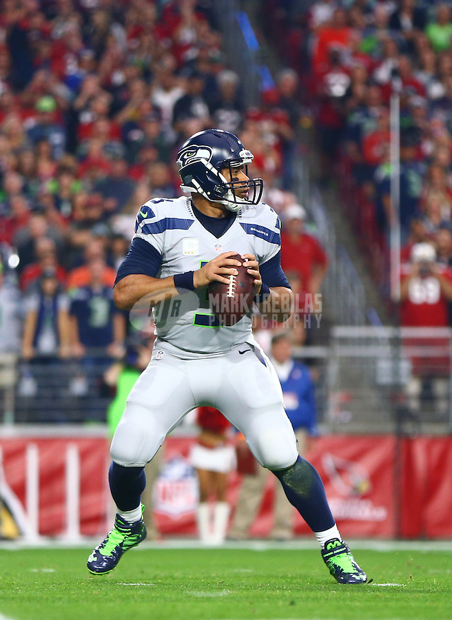 Jan 3, 2016; Glendale, AZ, USA; Seattle Seahawks quarterback Russell Wilson (3) against the Arizona Cardinals at University of Phoenix Stadium. Mandatory Credit: Mark J. Rebilas-USA TODAY Sports