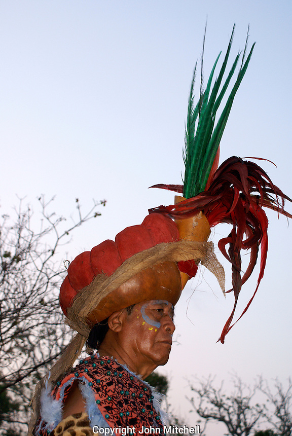 Maya elder wearing feathered headdress at the recreation of an ancient Mayan market, Sacred Mayan Journey 2011 event, Riviera Maya, Quintana Roo, Mexico