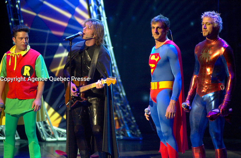 July 10, Montreal, Quebec, Canada<br /> <br /> Quebec musician Daniel Boucher, dressed as BATMAN, interpret a song while fellow musician Eric Lapointe, dressed as ROBIN (L),  and Olypmpic skating champion Marc Gagnon, dressed as SPIDERMAN (R) join <br /> Stand up comic Patrick Huard, dressed as SUPERMAN (M-R), for  a sketch on the opening night Gala of the 20th Juste Pour Rire Festival.<br /> <br /> <br /> <br /> Mandatory Credit: Photo by Pierre Roussel- Images Distribution. (&copy;) Copyright 2002 by Pierre Roussel <br /> <br /> NOTE : <br />  Nikon D-1 jpeg opened with Qimage icc profile, saved in Adobe 1998 RGB<br /> .Uncompressed  Original  size  file availble on request.