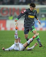 FUSSBALL   1. BUNDESLIGA  SAISON 2011/2012   16. Spieltag FC Augsburg - Borussia Moenchengladbach            10.12.2011 Paul Verhaegh (li, FC Augsburg) gegen Yuki Otsu (Borussia Moenchengladbach)