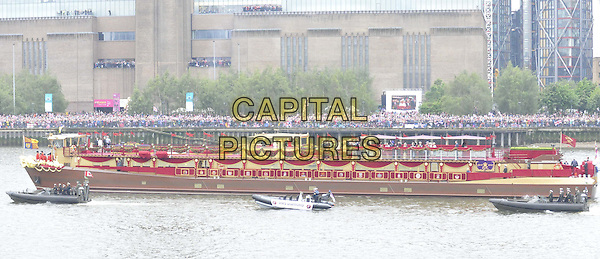 The Spirit of Chartwell.sailing ( past the Tate Gallery ) as part of the Diamond Jubilee River Pageant, River Thames, London, England..June 3rd, 2012.gv general view water river building flags.CAP/CAN.©Can Nguyen/Capital Pictures.