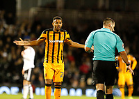 Fraizer Campbell of Hull City pleads his innocence during the Sky Bet Championship match between Fulham and Hull City at Craven Cottage, London, England on 13 September 2017. Photo by Carlton Myrie.