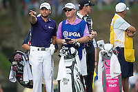 Jason Day and Col Swanton discuss tactics during the opening round of the US PGA Championship at Valhalla (Photo: Anthony Powter) Picture: Anthony Powter / www.golffile.ie
