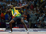 LONDON, ENGLAND - AUGUST 9:  Usain Bolt of Jamacia celebrates after the 200 meter finals during the Athletics Competition, Day 14 of the London 2012 Olympic Games on August 8, 2012 at Olympic Park in London, England. (Photo by Donald Miralle)
