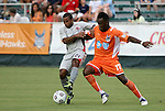 03 July 2012: Carolina's Gale Agbossoumonde (17) defends against Atlanta's Raphael Cox (21). The Carolina RailHawks defeated the Atlanta Silverbacks 2-1 at WakeMed Soccer Stadium in Cary, NC in a 2012 North American Soccer League (NASL) regular season game.