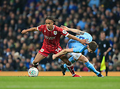9th January 2018, Etihad Stadium, Manchester, England; Carabao Cup football, semi-final, 1st leg, Manchester City versus Bristol City; Bobby Reid of Bristol City is tackled by John Stones of Manchester City