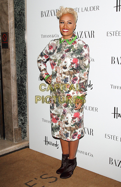 Emeli Sande.Harper's Bazaar Woman of the Year Awards at Claridge's Hotel, London, England..October 31, 2012 .full length black dress ankle boots white green brown red floral print hand on hip.CAP/ROS.©Steve Ross/Capital Pictures