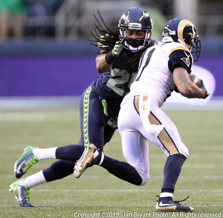 Seattle Seahawks cornerback Richard Sherman (25)  reaches for St. Louis Rams wide receiver Tavon Austin (11) at CenturyLink Field in Seattle, Washington on December 27, 2015.  The Rams beat the Seahawks 23-17.      ©2015. Jim Bryant Photo. All Rights Reserved