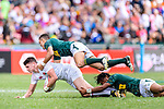 Stedman Gans (B) and Muller du Plessis of South Africa (U) put a tackle of Ben Howard of England (L) during the HSBC Hong Kong Sevens 2018 match between South Africa and England on April 7, 2018 in Hong Kong, Hong Kong. Photo by Marcio Rodrigo Machado / Power Sport Images