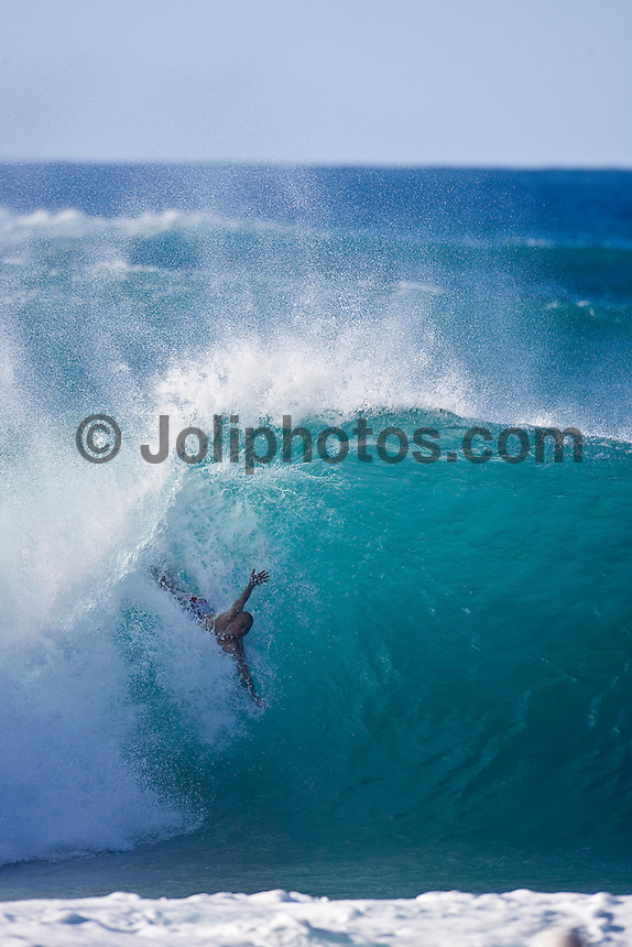 Eight times world professional surfing champion KELLY SLATER (USA)  body surfing at Pipeline, North Shore Oahu, Hawaii. Photo: joliphotos.com