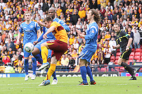 Steven Jennings clearing the ball before Michael Duberry tackles