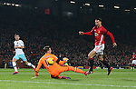 Zlatan Ibrahimovic of Manchester United scores the first goal past Adrian of West Ham United who catches his leg with his studs during the English League Cup Quarter Final match at Old Trafford  Stadium, Manchester. Picture date: November 30th, 2016. Pic Simon Bellis/Sportimage