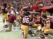 Landover, MD - December 22, 2002 --  Washington Redskins assistant coach Kim Helton goes over game photos with his offensive line during the game against the Houston Texans at FedEx Field in Landover, Maryland on December 22, 2002..Credit: Ron Sachs / CNP