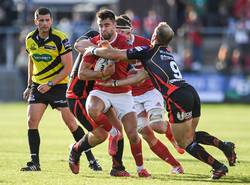 Conor Murray of Munster is tackled by Sam Hobbs and Sarel Pretorius of Dragons<br /> <br /> Photographer Craig Thomas/CameraSport<br /> <br /> Guinness PRO12 Round 3 - Newport Gwent Dragons v Munster Rugby - Saturday 17 September 2016 - Rodney Parade - Newport<br /> <br /> World Copyright &copy; 2016 CameraSport. All rights reserved. 43 Linden Ave. Countesthorpe. Leicester. England. LE8 5PG - Tel: +44 (0) 116 277 4147 - admin@camerasport.com - www.camerasport.com