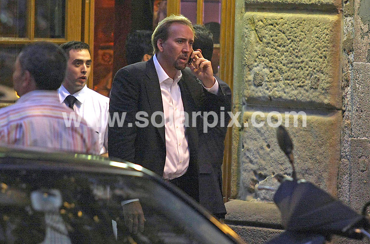 **ALL-ROUND PICTURES FROM SOLARPIX.COM**.**SYNDICATION RIGHTS FOR UK, AUSTRALIA & NEW ZEALAND ONLY**.Nicolas Cage visits Barcelona, Spain, with his wife, Alice Kim, and his son, Kel- El, where they celebrated their 6th wedding anniversary with an intimate dinner at Botafumeiro - a traditional Barcelona restaurant popular with celebrities. Barcelona, Spain. 29 July 2010..This pic: Nicolas Cage, having a heated phone call..JOB REF: 11802 SKX      DATE: 29_07_2010.**MUST CREDIT SOLARPIX.COM OR DOUBLE FEE WILL BE CHARGED**.**MUST NOTIFY SOLARPIX OF ONLINE USAGE**.**CALL US ON: +34 952 811 768 or LOW RATE FROM UK 0844 617 7637**