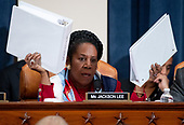 United States Representative Sheila Jackson Lee (Democrat of Texas), holds up copies of the Mueller Report as she questions constitutional scholars during a US House Judiciary Committee hearing on the impeachment of US President Donald Trump on Capitol Hill in Washington, DC, December 4, 2019.<br /> Credit: Saul Loeb / Pool via CNP