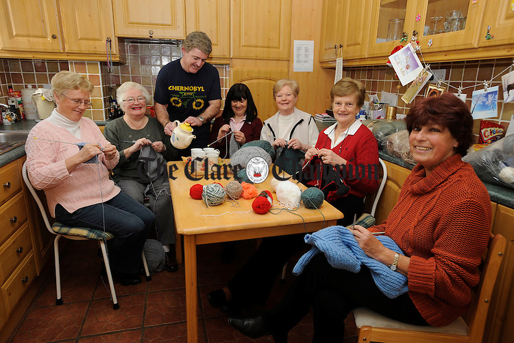 Parteen knitters hard at work; Angela Crowe, Ann Greene,  Jacqueline Rowan, Kathleen Duggan, Ann O Connell and Alice O Shaughnessy knitting jumpers for children in Belarus as Billy Rowan, of the East Clare Chernobyl Project, lends a hand to pour a hot cuppa for all! Photograph by John Kelly.