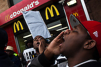 Fast food workers shout slogans for strike in front of a McDonald's restaurant while they take part in a  protest for Increased their wages in New York, April 04, 2013. Photo by Eduardo Munoz Alvarez / VIEWpress.
