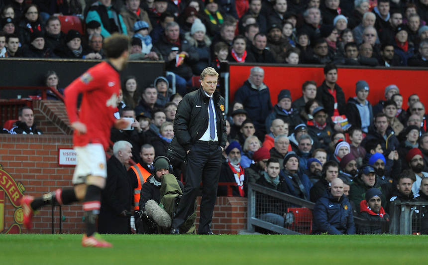 Manchester United's Manager David Moyes watches as his team trail 1-0 at half time<br /> <br /> Photo by Dave Howarth/CameraSport<br /> <br /> Football - Barclays Premiership - Manchester United v Fulham - Sunday 9th February 2014 - Old Trafford - Manchester<br /> <br /> &copy; CameraSport - 43 Linden Ave. Countesthorpe. Leicester. England. LE8 5PG - Tel: +44 (0) 116 277 4147 - admin@camerasport.com - www.camerasport.com