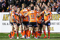 Picture by Alex Whitehead/SWpix.com - 06/03/2015 - Rugby League - First Utility Super League - Castleford Tigers v Wigan Warriors - the Mend A Hose Jungle, Castleford, England - Castleford's players celebrate the opening try by Justin Carney (second right).