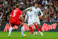 Dele Alli (Tottenham Hotspur) of England (right) takes on Andrei Agius of Malta (left) during the FIFA World Cup qualifying match between England and Malta at Wembley Stadium, London, England on 8 October 2016. Photo by David Horn / PRiME Media Images.