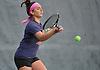 Lia Frankis of Manhasset returns volley during the Nassau County varsity girls' tennis doubles final at Eisenhower Park on Sunday, October 18, 2015.<br /> <br /> James Escher