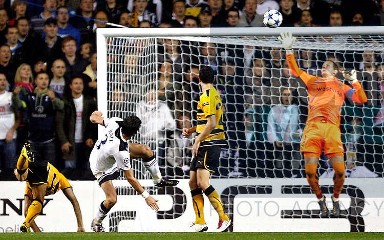 Gareth Bale of Tottenham Hotspur sees his header saved by Marco Wolfli of Young Boys