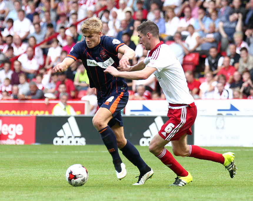 Blackpool's Brad Potts holds off the challenge from Sheffield United's Chris Basham<br /> <br /> Photographer Rich Linley/CameraSport<br /> <br /> Football - The Football League Sky Bet League One - Sheffield United v Blackpool - Saturday 22nd August 2015 - Bramall Lane - Sheffield<br /> <br /> &copy; CameraSport - 43 Linden Ave. Countesthorpe. Leicester. England. LE8 5PG - Tel: +44 (0) 116 277 4147 - admin@camerasport.com - www.camerasport.com