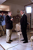 United States Secretary of Defense Donald H. Rumsfeld talks with Dan Rather of CBS News before an interview for the network's evening news broadcast on September 5, 2003, in Baghdad, Iraq.      .Mandatory Credit: Andy Dunaway / DoD via CNP