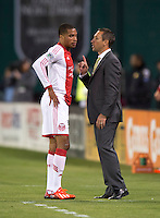 Portland Timbers head coach Caleb Porter talks to forward Ryan Johnson (9) during a Major League Soccer match at RFK Stadium in Washington, DC.  The Portland Timbers defeated D.C. United, 2-0.