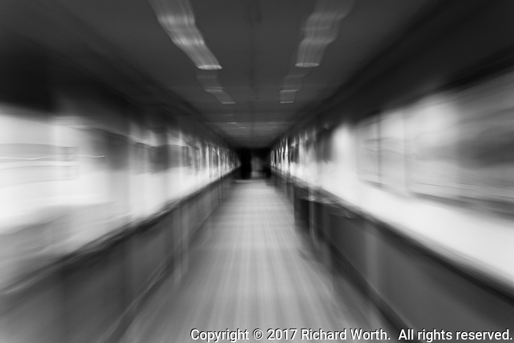 Abstract of a hallway, black and white with slow-shutter blurred motion.