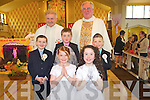 Pupils from Knocknasna NS who made their First Holy Communion  last Saturday in The Church of The Assumption last Saturday were l-r Jack Curtin, Claire Marie O'Connor, Kevin Lane, Michelle Flynn and Diarmaid Healy, also pictured were Fr Liston and Canon O'Shea.