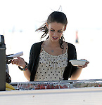 8-19-09...Jessica Lowndes kissing Trevor Donovan on the beach in Santa Monica California. Jessica was doing most of her own makeup putting on lipstick in between scenes. Trevor got some lipstick on his teeth & had some trouble wiping it off whith a white napkin...AbilityFilms@yahoo.com.805-427-3519.www.AbilityFilms.com.