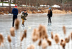 MIDDLEBURY,  CT-122616JS07-- Nick Salerno, 18, of Southbury, center, works on his puck handling skills while skating with friends Jackson Morris, 17, of Middlebury and Kaeleigh Canty, 18 of Southbury Monday at Fenn's Pond in Middlebury. <br />   Jim Shannon Republican American