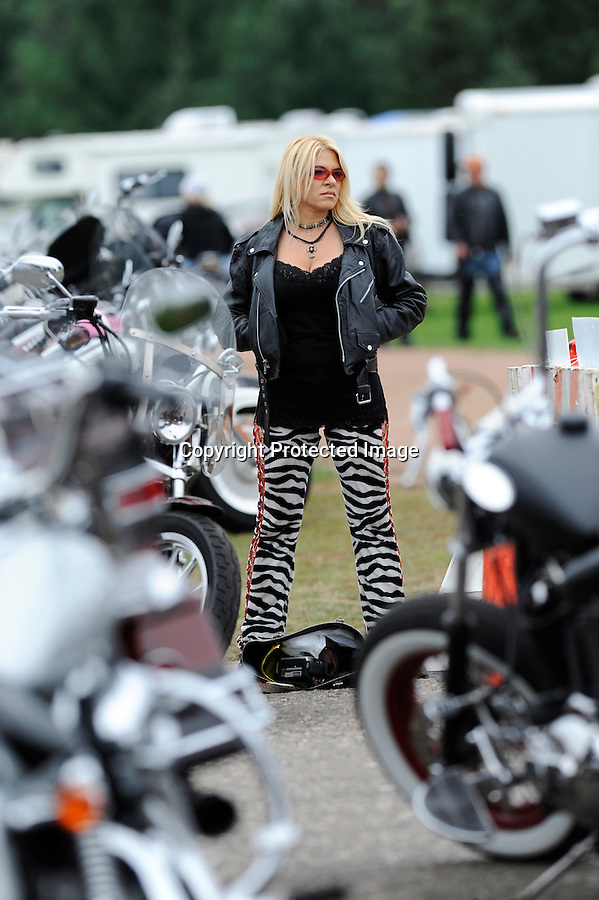 Sazzy Lee Varga, a model, is pictured near motorcycles at the 2010 Tomahawk Fall Ride, a gathering of motorcyclists of all brands, but predominantly Harley-Davidson, in Tomahawk, WI.