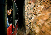 A passenger watches as The Chihuahua Pacific Railway Train passes over a bridge through Barranca del Cobre (Copper Canyon) using the last passenger train in Mexico, Friday, June 20, 2008. The train has run daily since 1961 and passes over 408 miles of railroad tracks, through 86 tunnels and over 37 bridges on its voyage...PHOTOS/ MATT NAGER